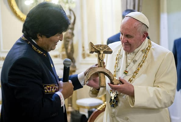 This HO picture provided by Vatican newspaper L'Osservatore Romano shows Pope Francis receives a Crucifix on a hammer and sickle as a gift from Bolivian president Evo Morales, in El Alto, Bolivia, 09 July 2015. ANSA/OSSERAVATORE ROMANO ANSA PROVIDES ACCESS TO THIS HANDOUT PHOTO TO BE USED SOLELY TO ILLUSTRATE NEWS REPORTING OR COMMENTARY ON THE FACTS OR EVENTS DEPICTED IN THIS IMAGE; NO ARCHIVING; NO LICENSING